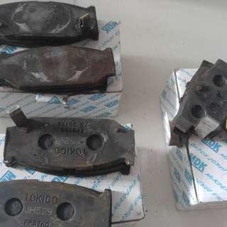 Swift frt used brake pads / rain visor driver side foc
