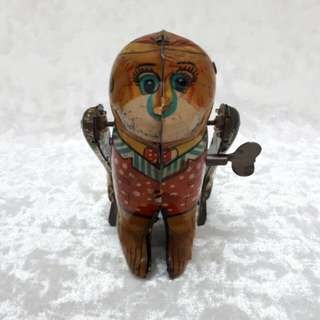 Vintage monkey metal toy