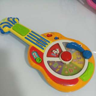 Toy Guitar (English & French)