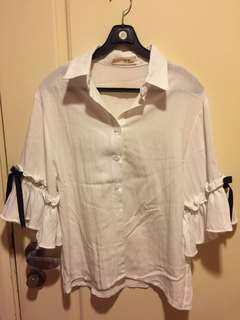 white blouse with ribbons on the sleeve from Korea