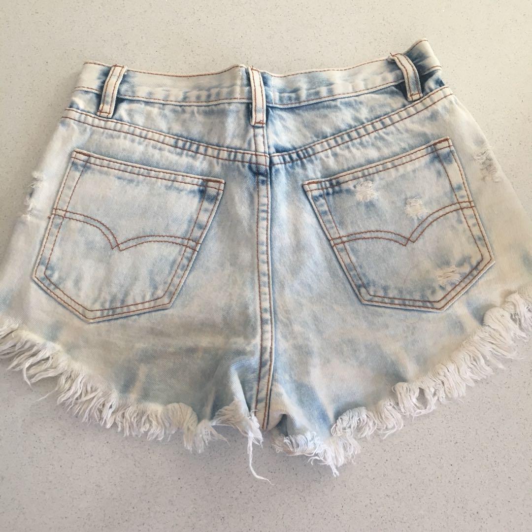 Light wash denim distressed shorts