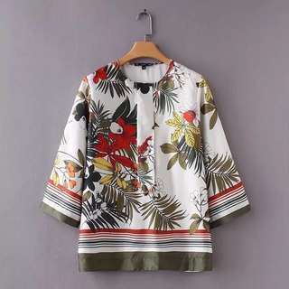 Loose fitting European and American women's fashion flower print round collar shirt