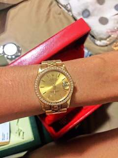 Rolex solid hold with diamonds