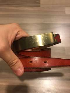 bn red skinny belt in free size with gold buckle