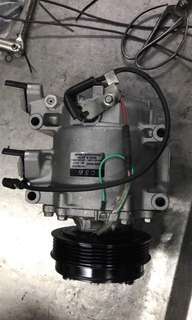 compressor aircond honda jazz 2009