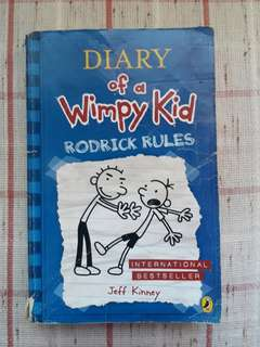 Diary Of A Wimpy Kid with a chinese book
