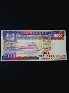 Singapore ship.series.$1000  low no A/1 000224 in cantonese meanss everyday happy AU/UNC