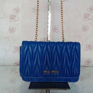 preloved Miu Miu sling blue