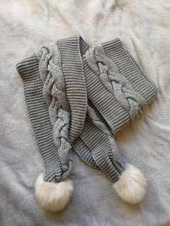 Grey knit scarf w/ pom poms