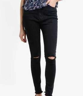 black highwaisted slashed skinny jeans