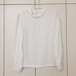 White polyester long sleeved blouse with sleeve detail