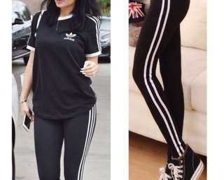 black leggings with double white side stripes