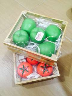 Apples and tomatoes Candles with wooden racks