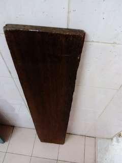 Solid wood piece in dark brown