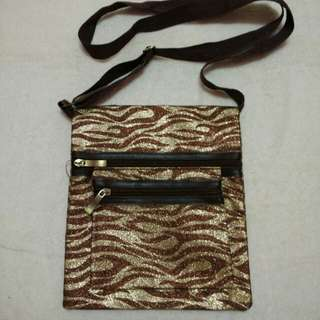 Glittery animal print string bag