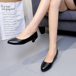 black leather court shoes.
