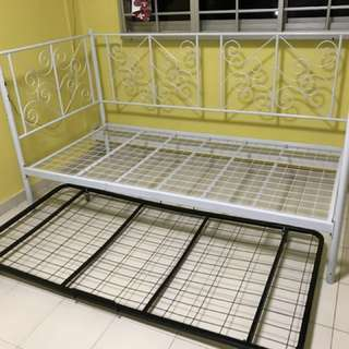 Single bed frame with mattress and pull out frame.