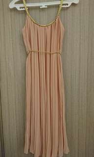 Pink grecian-style pleat dress