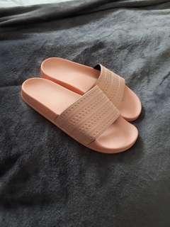 Pink Adidas slip on sandals