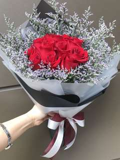 12 red roses and purple Caspia Bouquet