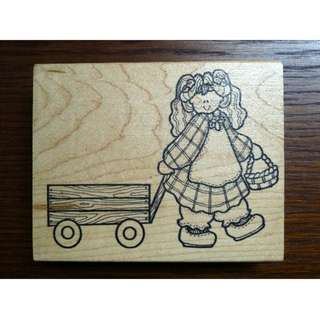 Girl pulling wagon with basket wooden rubber stamp