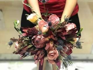 Protea and roses bouquet