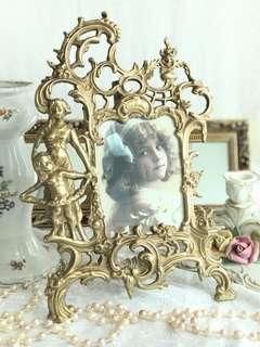 Antique victorian ornate bronze frame.