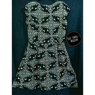Sleeveless Aztec-designed dress
