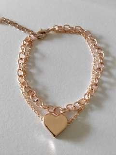 Rose gold multi row heart bracelet