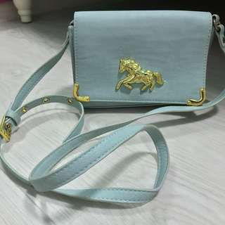 ASOS small gold horse bag in baby blue