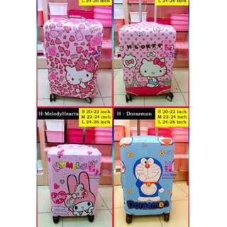 Many Stocks! Luggage Covers Protector Hello Kitty / Melody / Doraemon available for purchase at Paya Lebar Warehouse Store @ beside Paya Lebar MRT