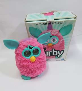 Furby. Pink with turquoise ears.