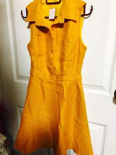 Mustard sleeveless office dress with pockets
