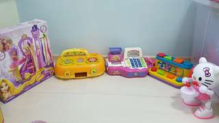 Toys for kids - assortment including winnie the pooh cooking stove, cashier toy, hello kitty lantern and Rapunsels hair studion
