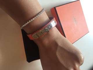 Hermes Kelly lock bracelet orange