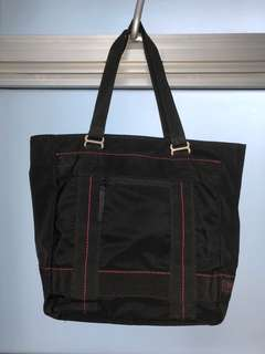 Black tote with red lining