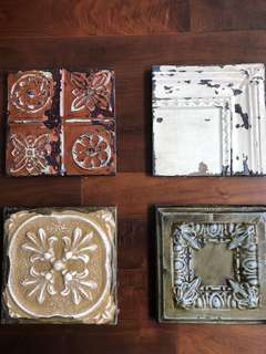 Four tin decorative panels