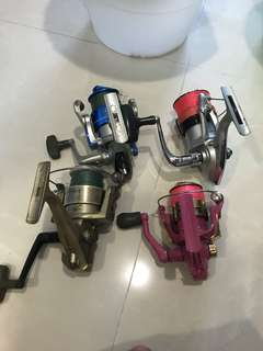 Lot of 4 fishing Reels (not for fussy buyers)