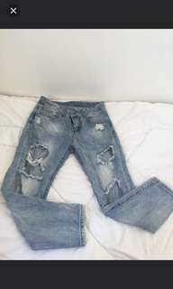 Used ripped jeans size 25-26