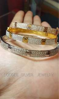 Cartier bangle accessories with diamonds