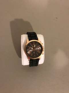 Rose gold with black strap watch