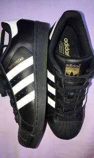 Black adidas superstar shoes