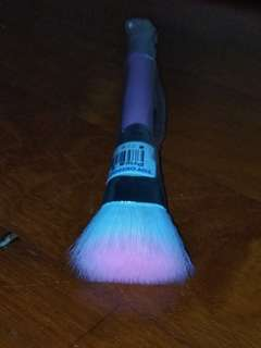 Fluffy pink flat top foundation brush