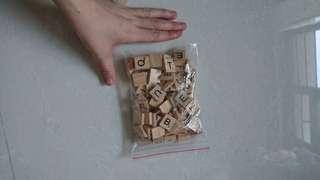 Wooden scrabble tiles. Random alphabets