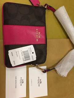 100% new Coach Corner Zip Wristlet in signature coated canvas w/leather