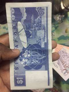 Old Singapore dollar paper
