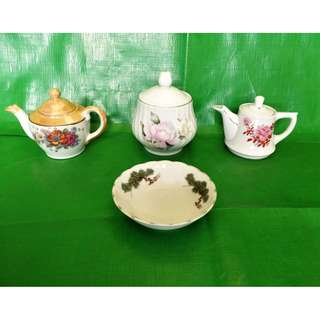 A group of teapots, sugar bowl and saucer 4 pieces