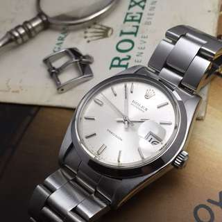 SOLD-      34mm Rolex 6694 Oysterdate Silver Sunburst with Official Cert