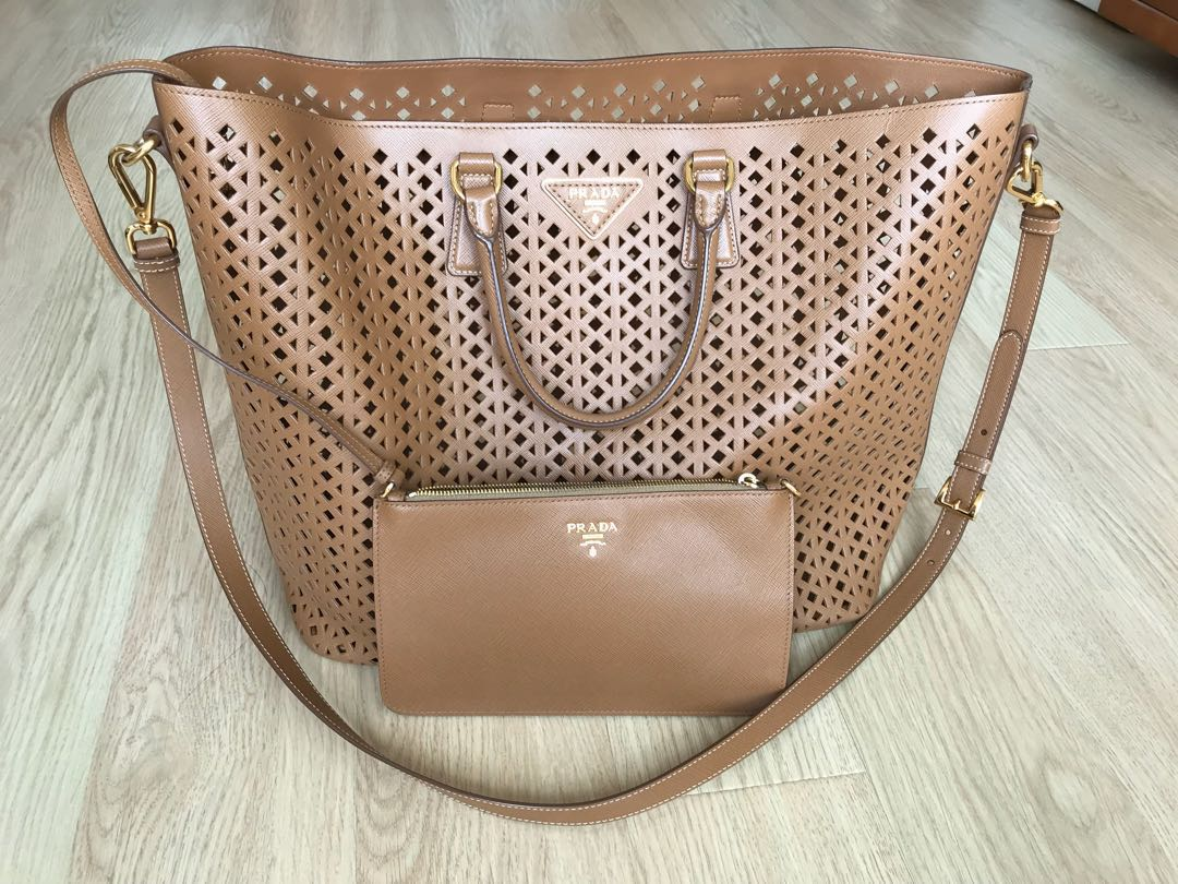 Parade Caramel Cut-out Saffiano Garderobe, Women s Fashion, Women s Bags    Wallets on Carousell f998a650c1