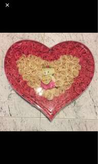 Handmade rose-petals soap lined in a heartshape with a bear